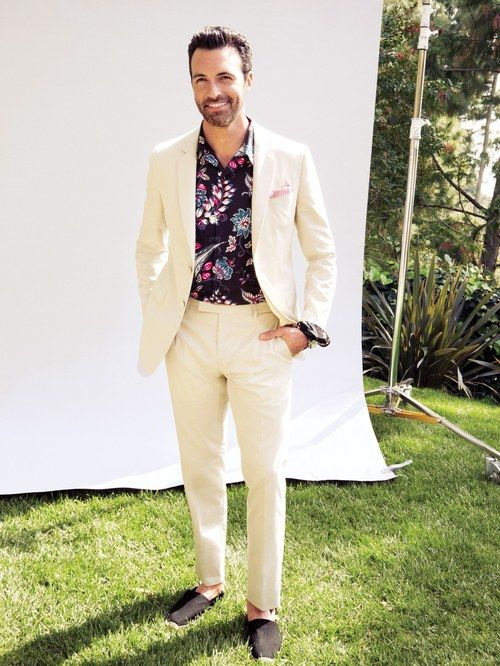 a cremay suit, black espadrilles and a moody floral shirt, which is great for a tropical wedding