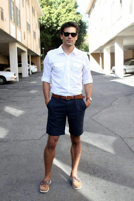 a white shirt, navy shorts, a brown belt and brown moccasins plus sunglasses for a comfy look