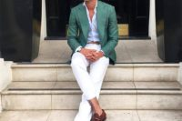 creamy cropped pants, a white shirt, a green blazer, brown moccasins and sunglasses