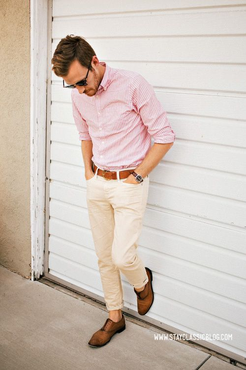 cremay pants, a pink striped shirt, brown shoes and a brown belt plus sunglasses for an effortlessly chic look