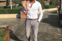 grey chinos, a white shirt, brown moccasins, a tan blazer and sunglasees for a chic outfit