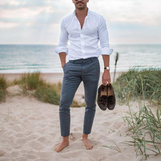grey cropped pants, a white shirt, brown moccasins and a watch are all you need to look cool