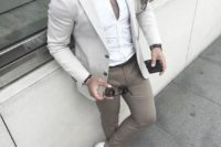 khaki chinos, a white shirt and sneakers, a creamy blazer and a pocket square for a stylish neutral look