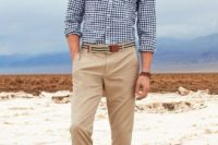tan pants, a blue and white plaid shirt, no tie, brown moccasins for a casual beach wedding guest look