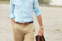 tan pants, a light blue shirt, black and brown moccasins and sunglasses are all you need for a chic look