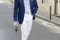 white jeans, a light blue shirt, a blue blazer and blue sneakers for a touch of casual
