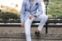 white pants, a striped navy and white shirt, a light blue blazer and brown shoes with no socks