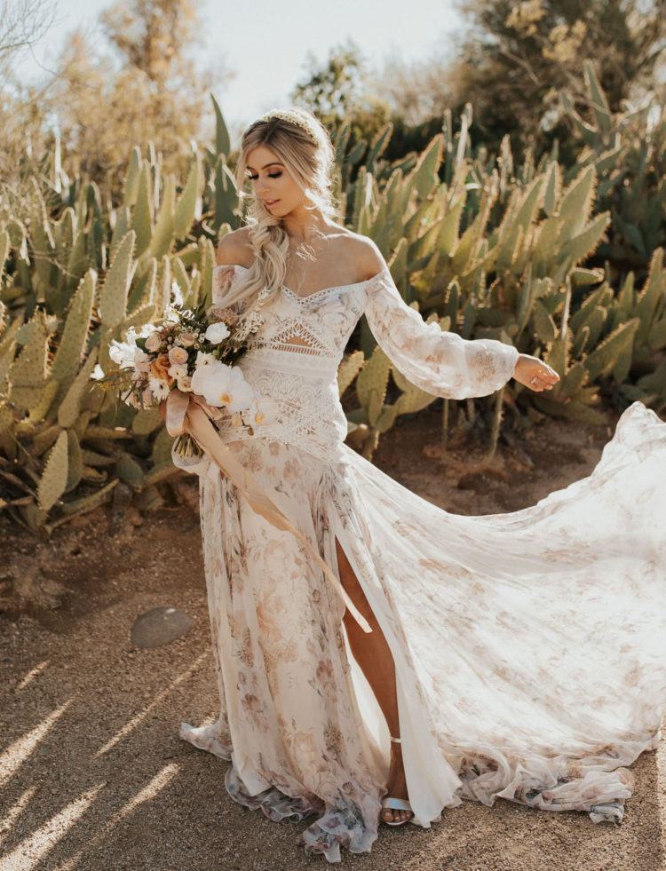 The bride was wearing a fantastic off the shoulder floral wedding dress with a side slit, long sleeves and intricate lace