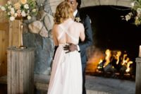 a very cute and interesting wedding dress with a train