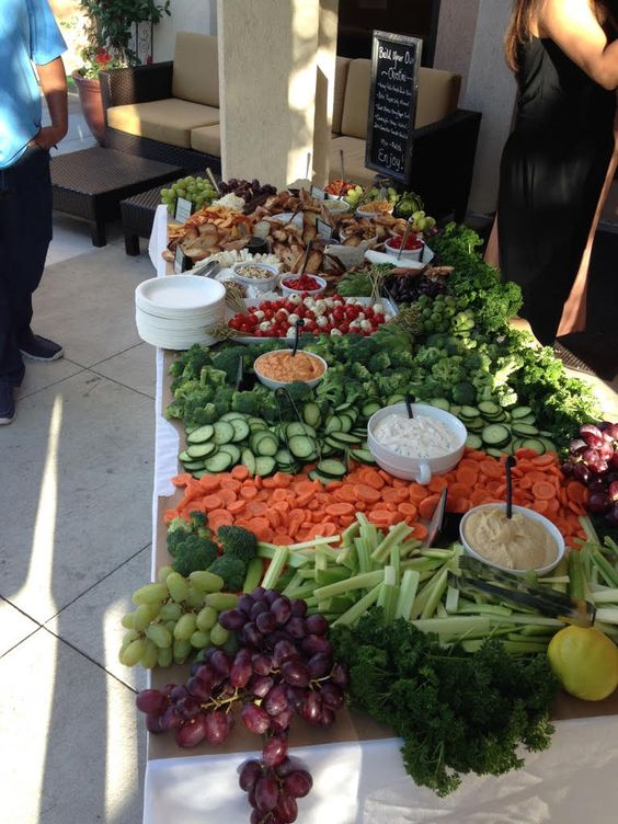 a fresh veggie and fruit salad bar with various kinds of dressing is a great idea that works for any wedding