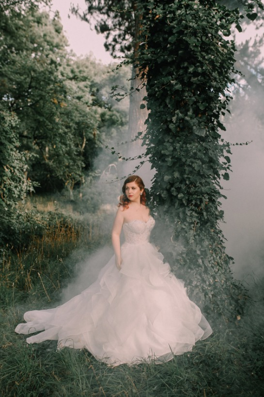a gorgeous strapless sweetheart neckline wedding ballgown with a full ruffled skirt
