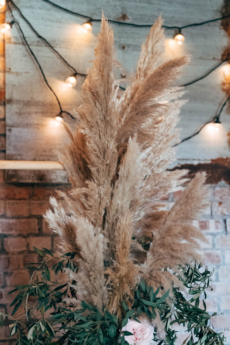 Pampas grass was added to the wedding decor, it's a hot trend for weddings