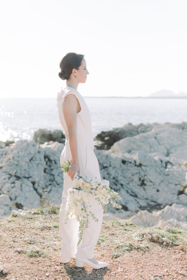 The second bride was rocking a modern plain jumpsuit with pockets and a cutout back plus an updo