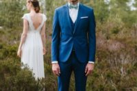 03 a bold blue three-piece suit, a white shirt, a colorful bow tie and white sneakers for a modern groom's look