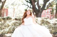 03 a cute strapless wedding ballgown with a sweetheart neckline, an embellished sash and a layered skirt
