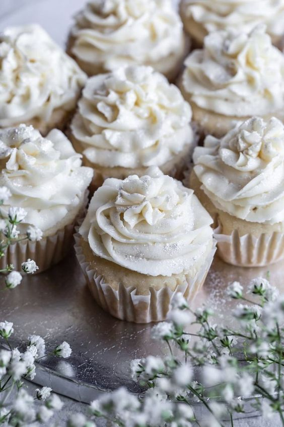 vegan gluten free vanilla cupcakes topped with edible silver glitter is a cute idea for a vegan wedding