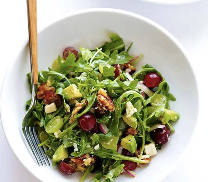 vegan salad of grapes, avocado, arugula is light and refreshing, and it leaves some space for the cake