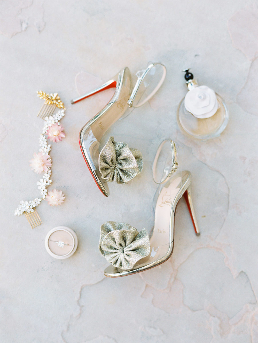 The bride was rocking whimsy heels and cute floral accessories