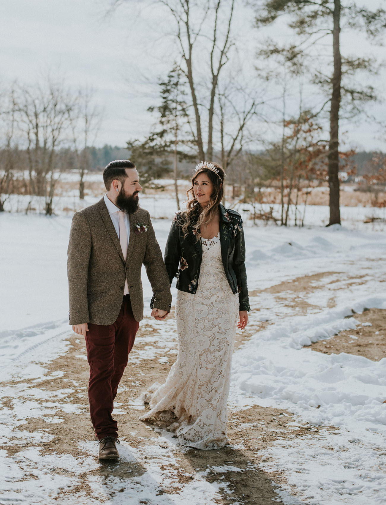 The bride was wearing a lace off the shoulder wedding dress, an embroidered leather jacket and a bold crystal headpiece