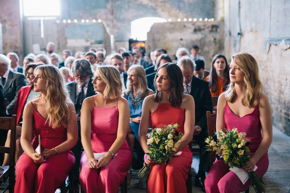 bridesmaids in bright jumpsuits look aweome