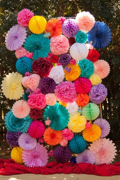 a colorful fan and 3D ball backdrop is a fun idea that you may easily DIY, add color to your pics