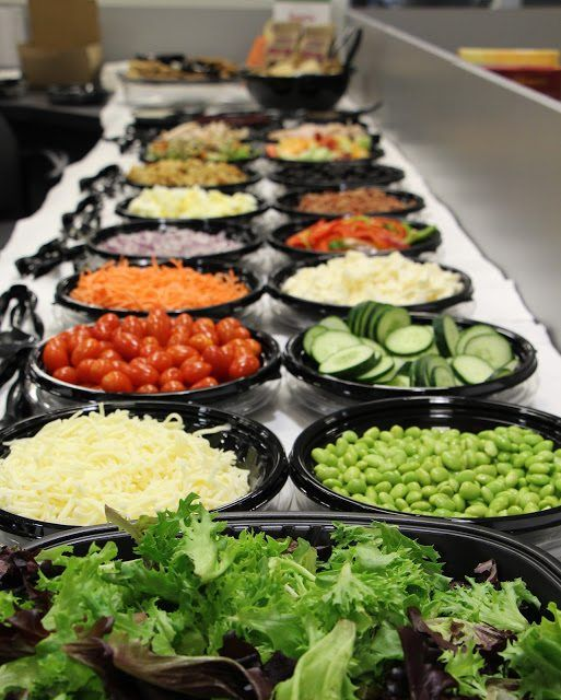 a delicious wedding salad bar arranged in large black bowls for a modern feel