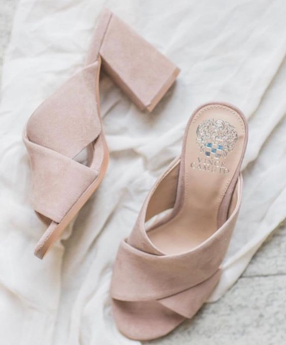 blush mules are a trendy statement that can finish off a tender and romantic bridal look and add an edgy feel