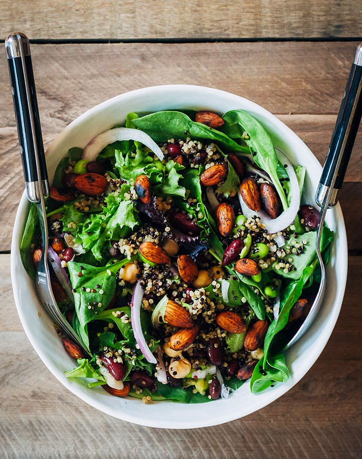 mixed greens, quinoa, paprika, onions and roasted almonds salad is a delicious option for your vegan wedding