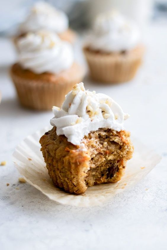 vegan carrot cupcakes with coconut whipped cream, orange, ginger and raisins are fantastic