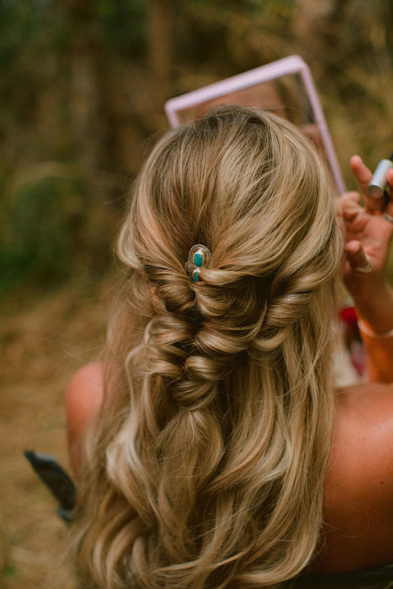 Her hairstyle was a twisted braid accented with a turquoise hairpin