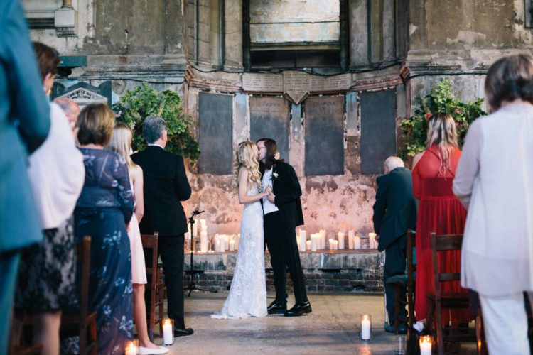 The ceremony took place in a concrete chapel decorated with greenery and candles