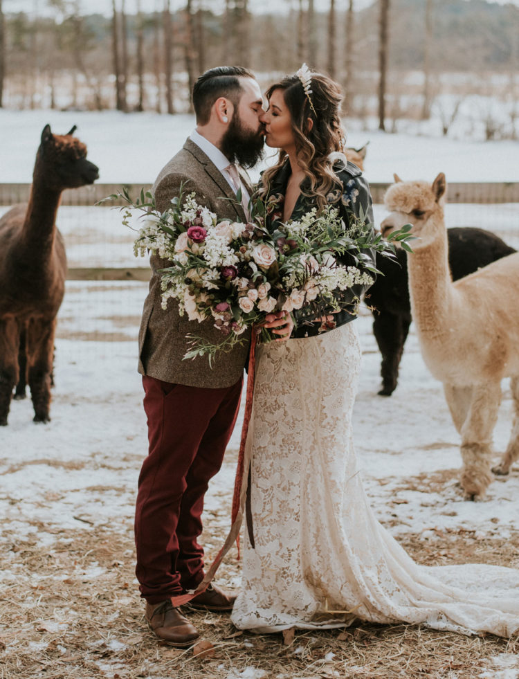 The groom was wearing a tweed blazer, a blush tie, burgundy pants, brown shoes