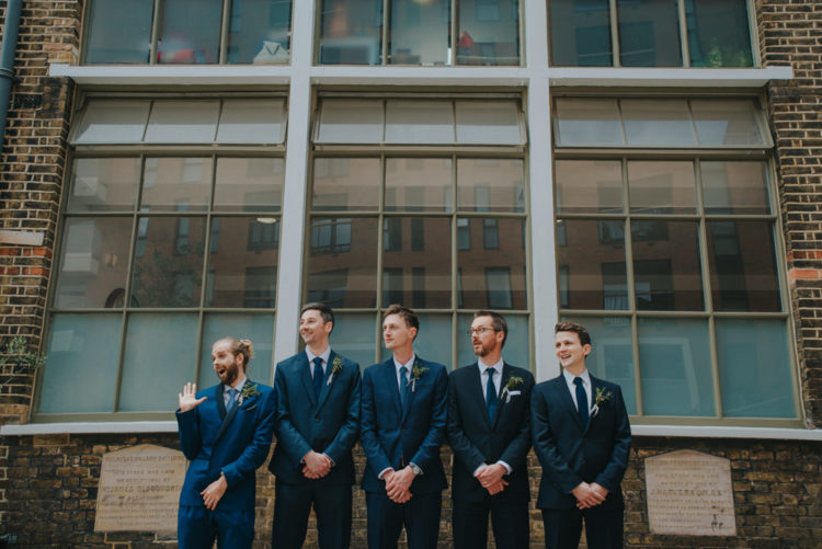 The groomsmen were rocking navy suits and blue ties, too