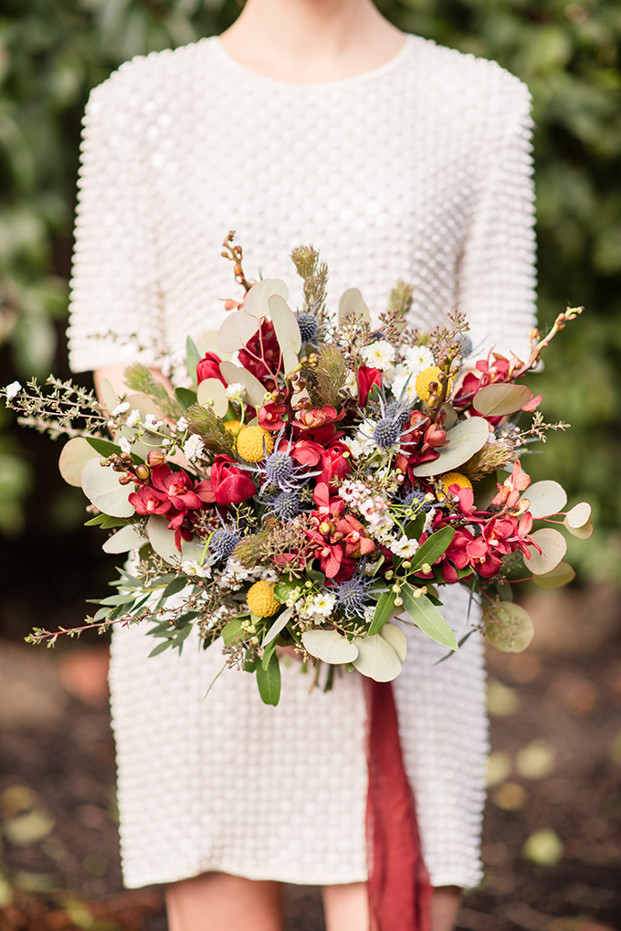 The wedding bouquet was done with lots of colorful blooms, greenery and textural herbs