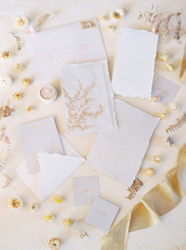 The wedding stationery was neutral and accented with a raw hem