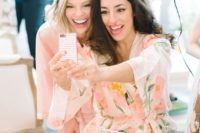 05 a bride and maid of honor taking some selfies while getting ready in the morning is a fun idea