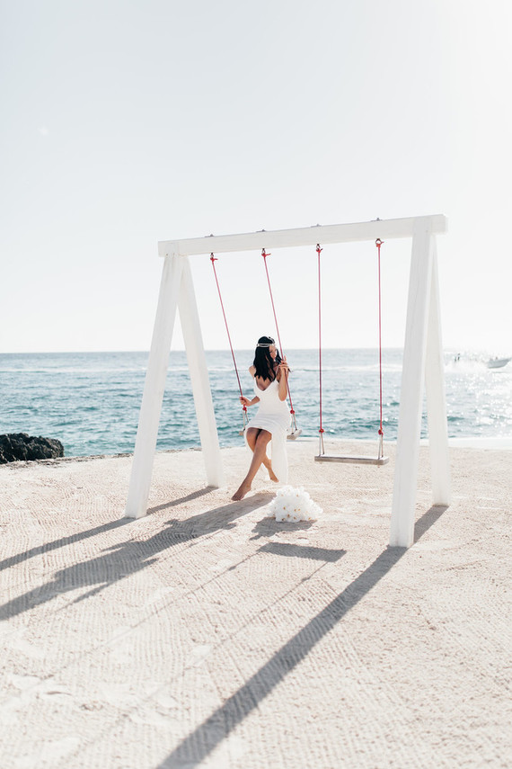 Swinging next to the sea is very dreamy