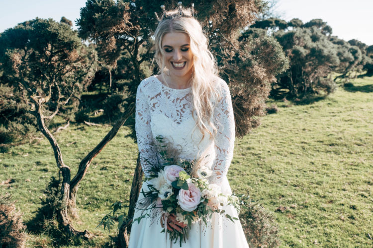 bride with a quite neutral wedding bouquet looks chic