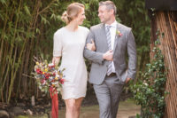 06 The groom was wearing a grey suit, a white shirt, a grey striped tie and brown shoes