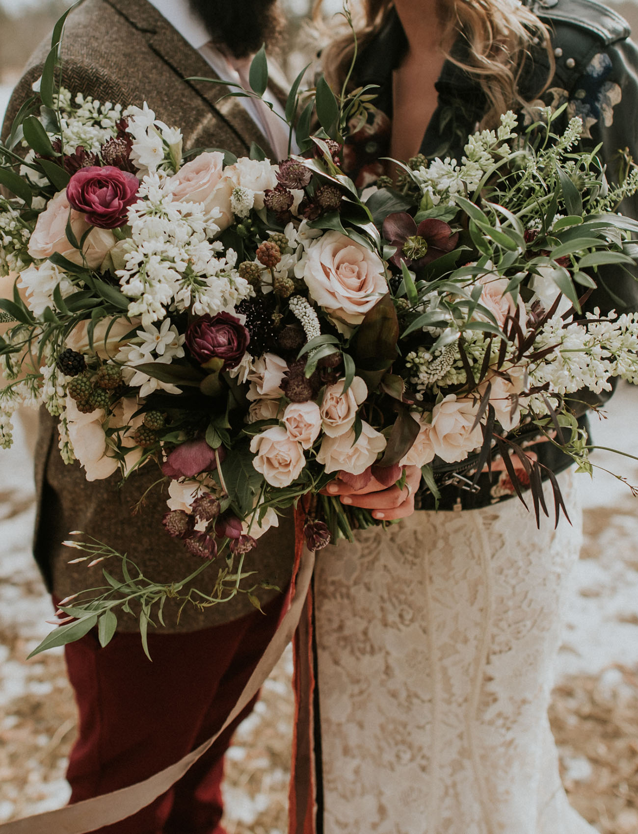 What a gorgeous and lush wedding bouquet done with blush blooms, burgundy ones and some berries