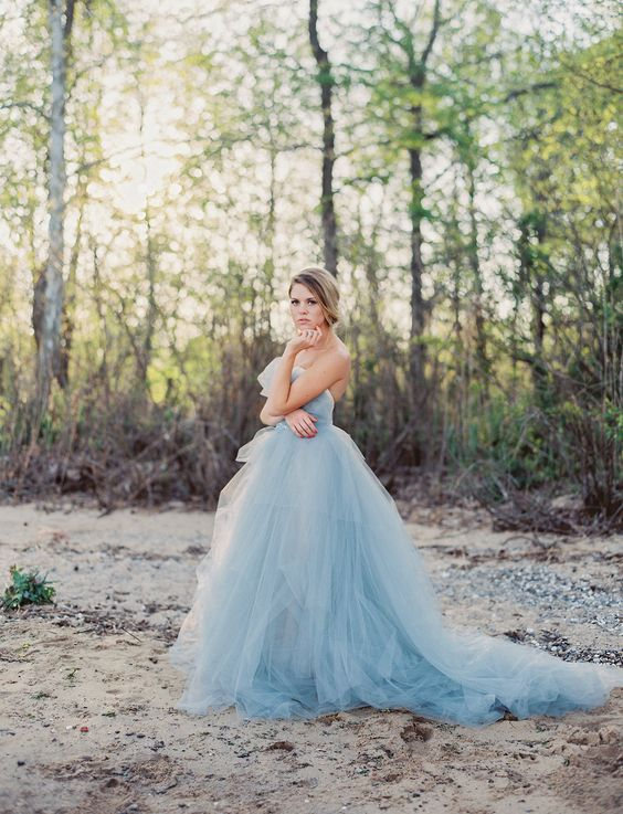 a strapless blue wedding ballgown with a draped bodice and a layered skirt with a train for your 'something blue'