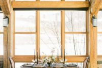 07 A cozy reception space was created by the window with snowy views