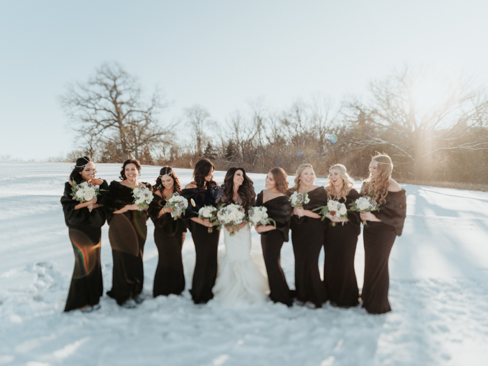 The bridesmaids were wearign chocolate brown and matching faux fur stoles