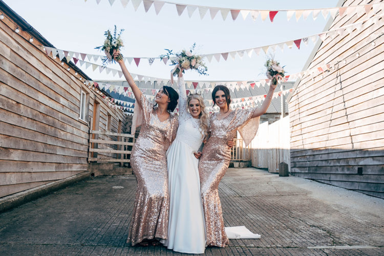 The bridesmaids were wearing rose gold sequin maxi dresses with wide sleeves
