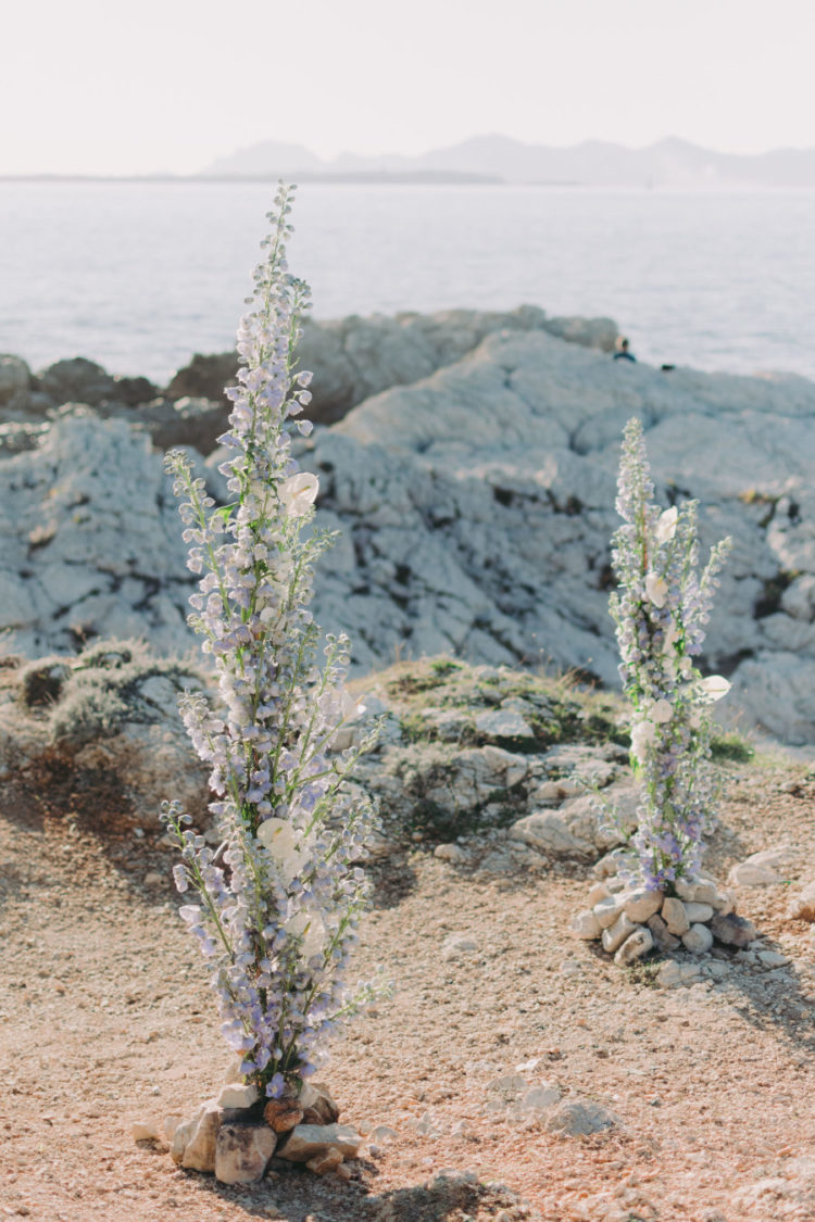 The wedding ceremony space was done in light blues and white with beach rocks