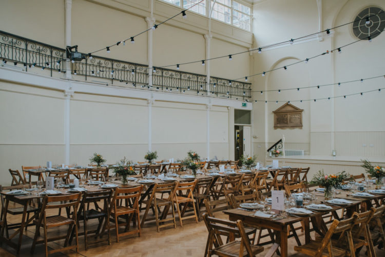 The wedding reception space was done with wooden tables and chairs