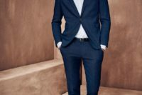 07 a chic navy suit, a white shirt, no tie and white sneakers with no socks for an elegant modern outfit