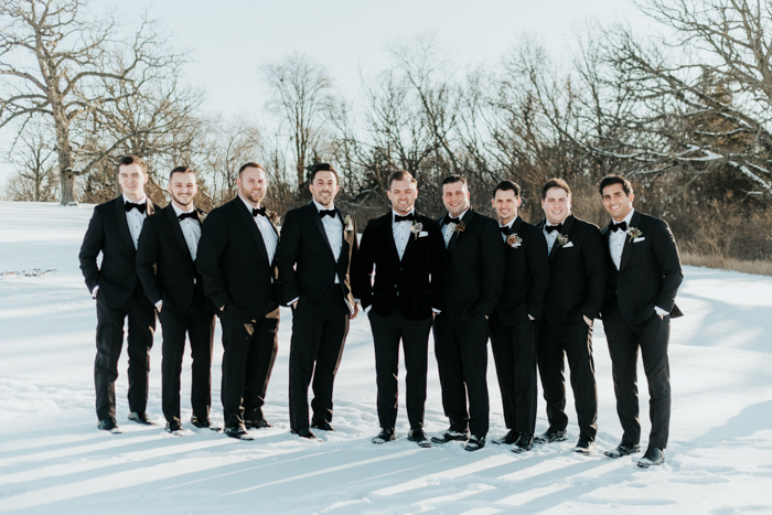 The groomsmen were rocking black tuxes