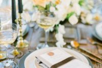 08 The table setting was done with neutral textiles, matte chargers, black candles and neutral and muted tone blooms