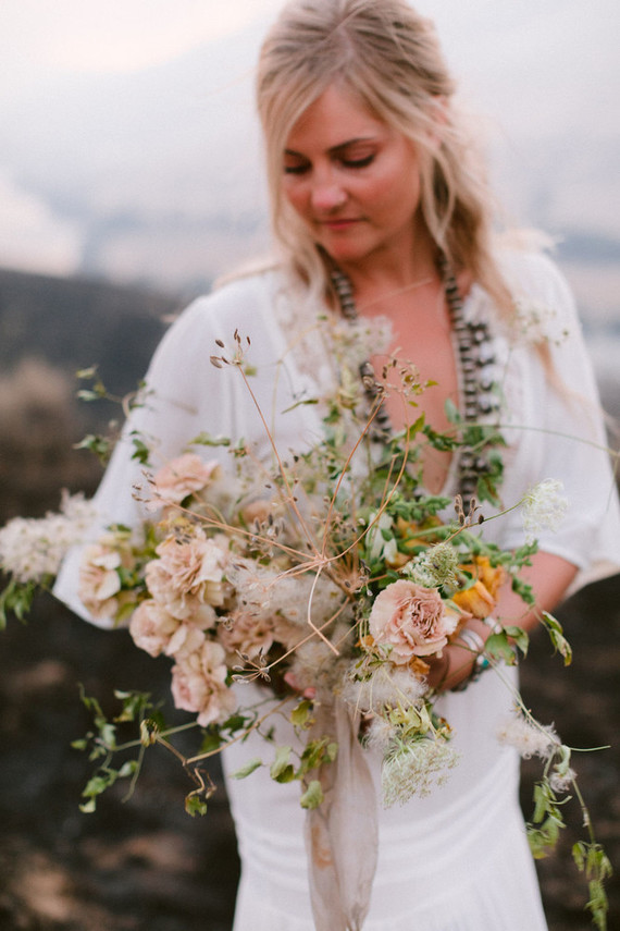The wedding bouquet was of carnations and some dried herbs and greenery